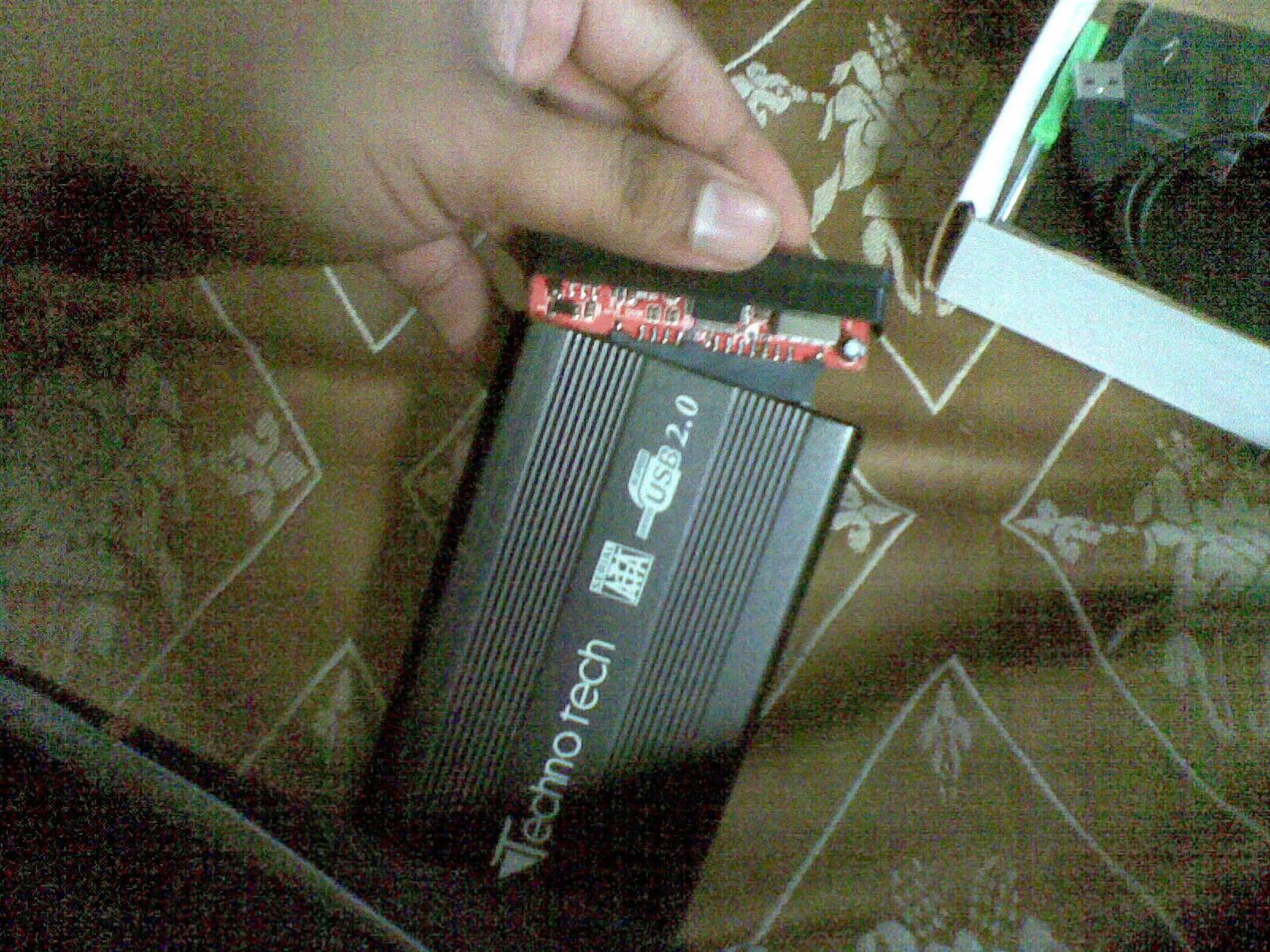 Open The Casing Remove SATA-USB Bridge